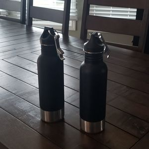 2- bottle armour bottles, black and silver